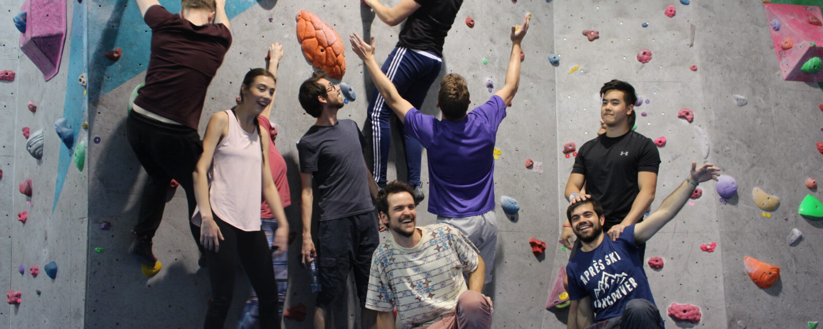 A group of young adults having fun at the City Bloc climbing wall