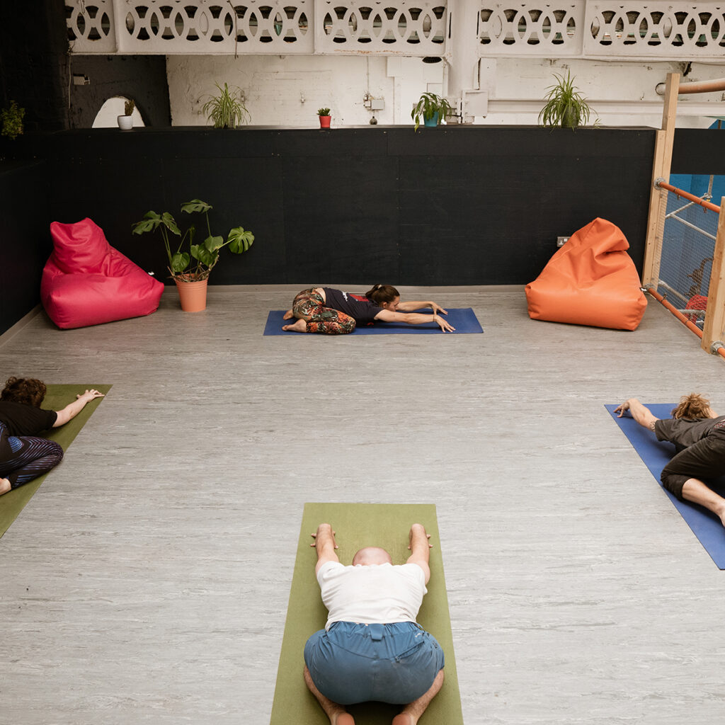 Social distance yoga at city bloc